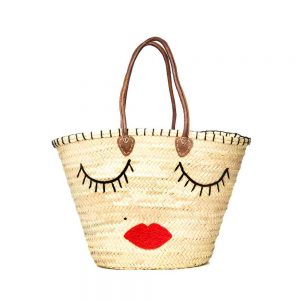 Hand woven Moroccan straw tote bag with kiss face detail