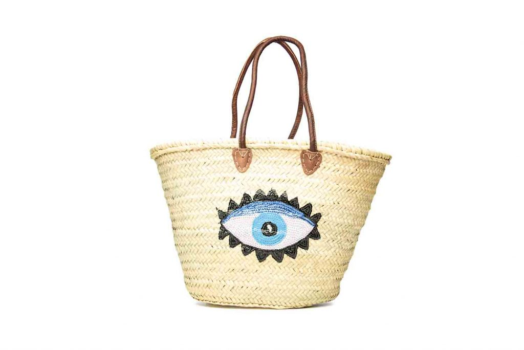 Hand woven Moroccan straw tote bag with eye detail